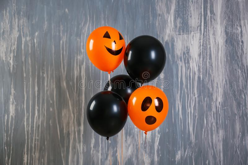 Color balloons for Halloween party on grey background stock image