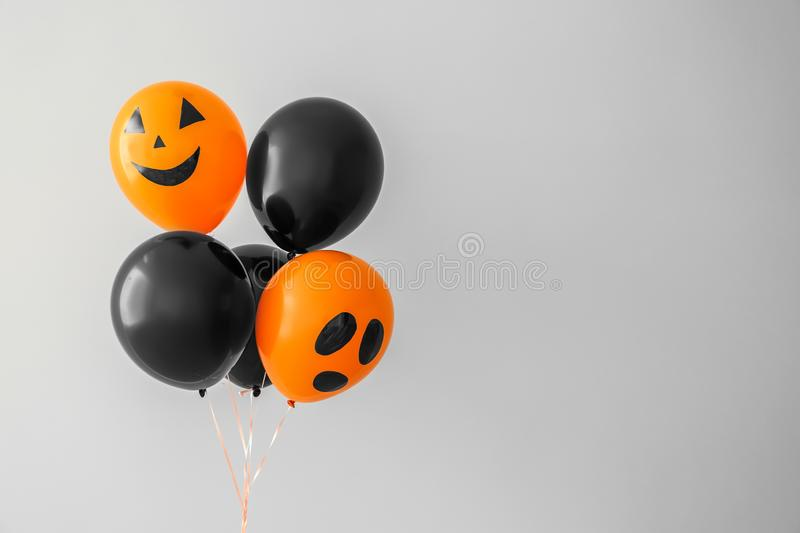 Color balloons for Halloween party on light background stock photography