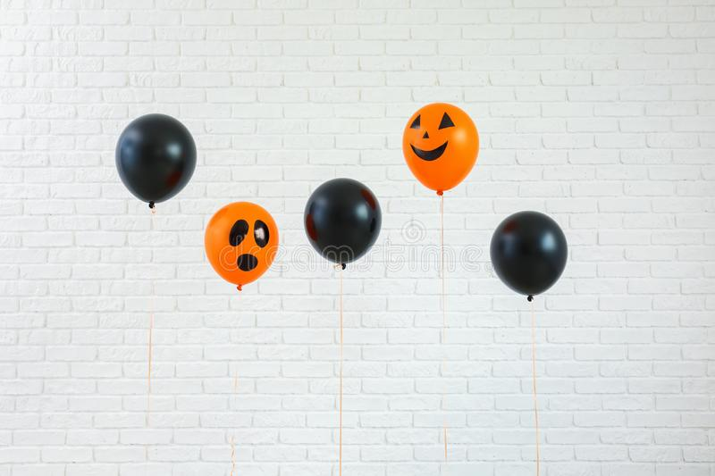 Color balloons for Halloween party on light background royalty free stock photo