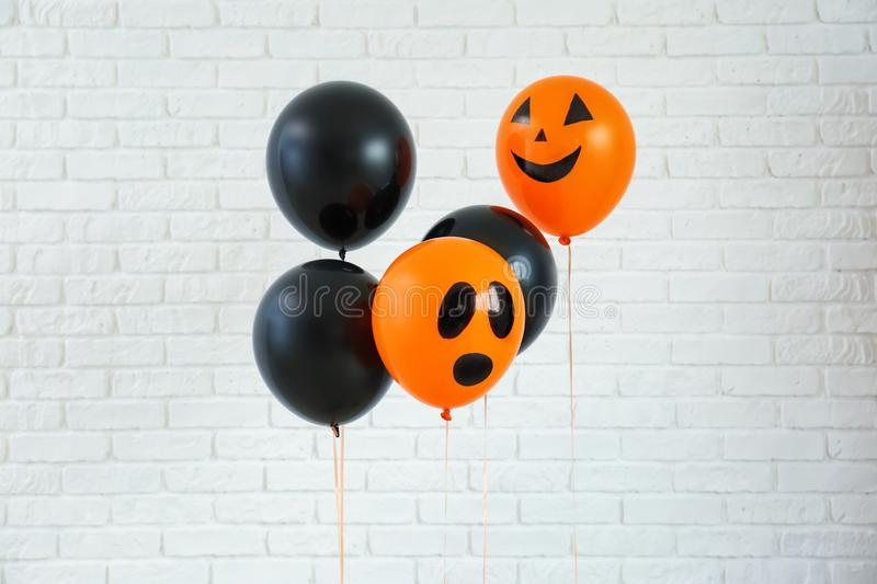 Color balloons for Halloween party on light background royalty free stock images