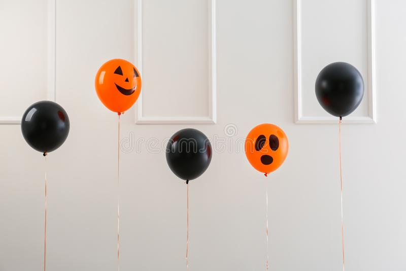 Color balloons for Halloween party on light background stock photos