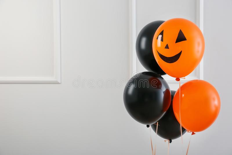 Color balloons for Halloween party on light background stock images