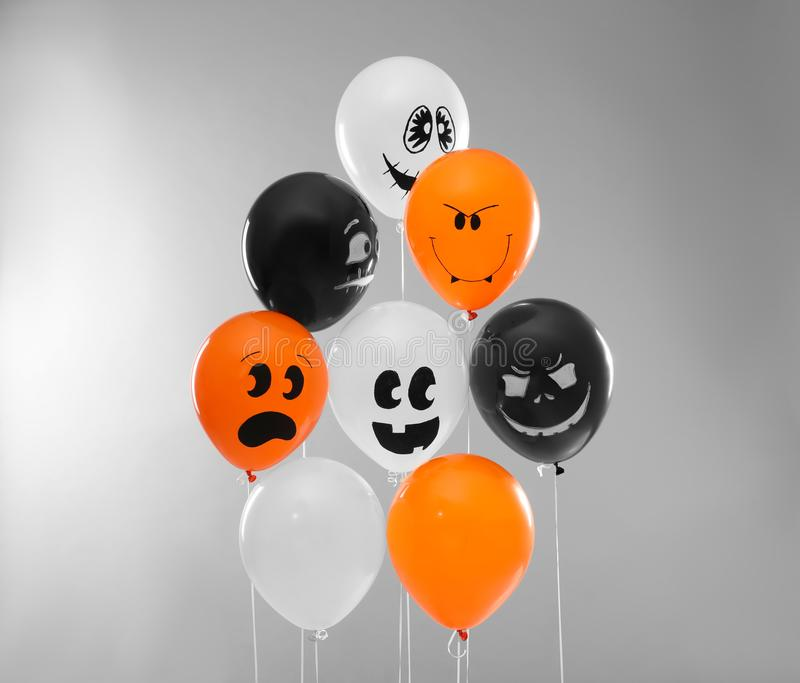 Color balloons for Halloween party on light grey. Background royalty free stock photography