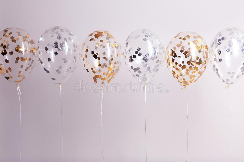 Color balloons with ribbons on white. Background stock photography