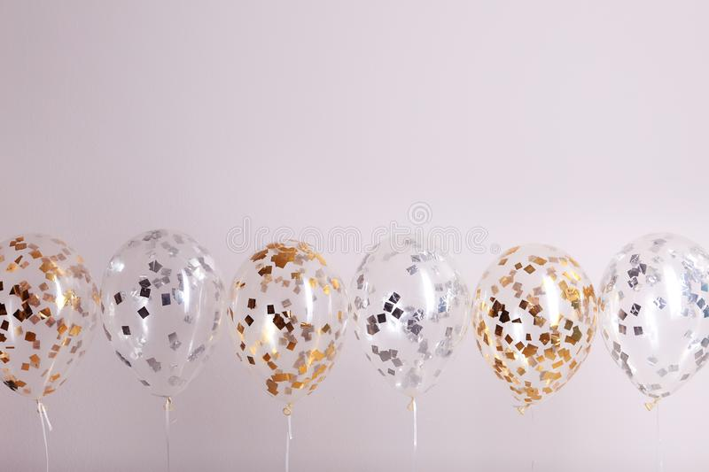 Color balloons with ribbons. On white background royalty free stock image