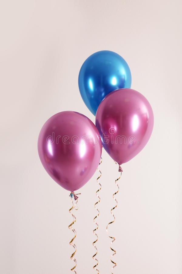 Color balloons with ribbons. On white background stock photos