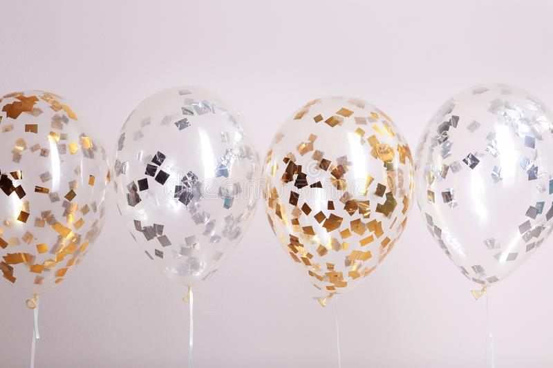 Color balloons with ribbons. On white background stock image