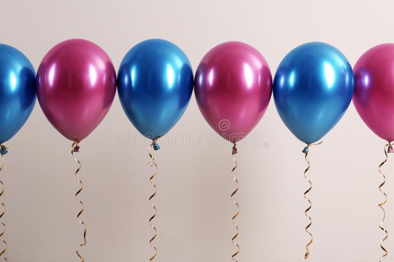 Color balloons with ribbons. On white background royalty free stock images