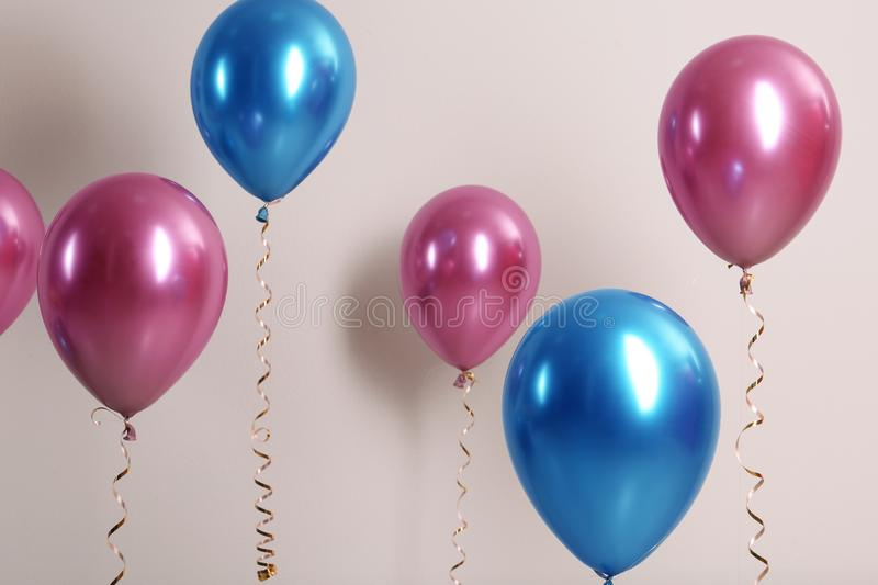 Color balloons with ribbons. On white background royalty free stock photography