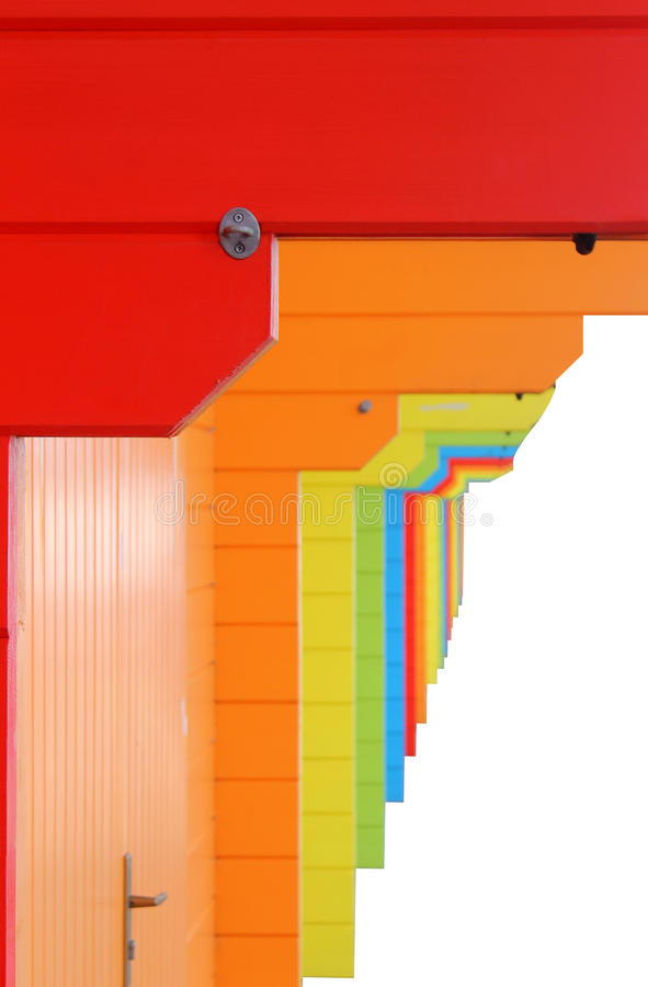 Color beach chalets in row. Isolated on a white background stock photography