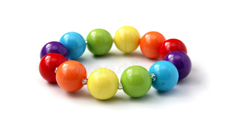 Color beads. Color beads close up on a white background royalty free stock photo