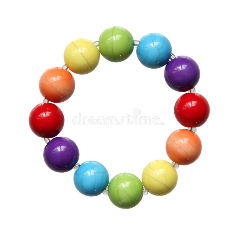 Color beads close up on a white background. royalty free stock photography