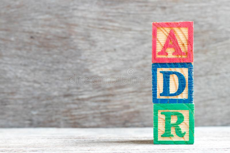 Color block in word ADR Abbreviation of adverse drug reaction on wood background. Color letter block in word ADR Abbreviation of adverse drug reaction on wood royalty free stock photo