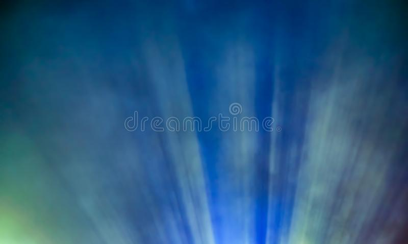Color blured projector light beam through smoke stock photo