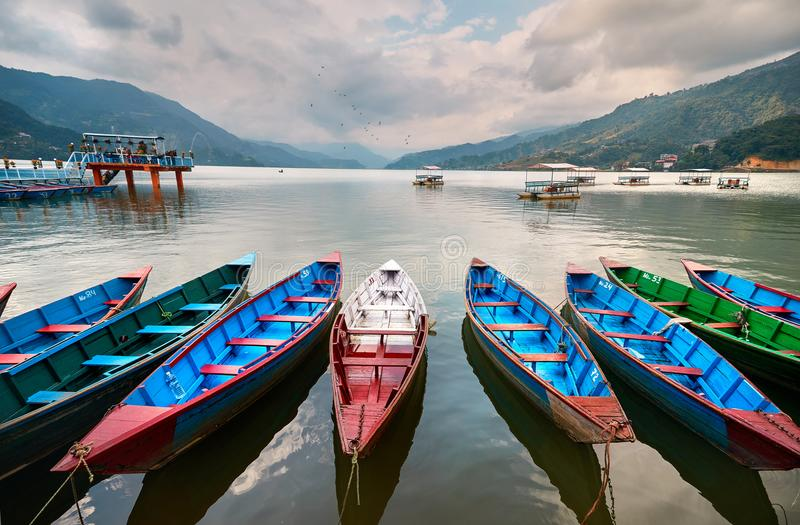 Colorful boats in Pokhara royalty free stock images