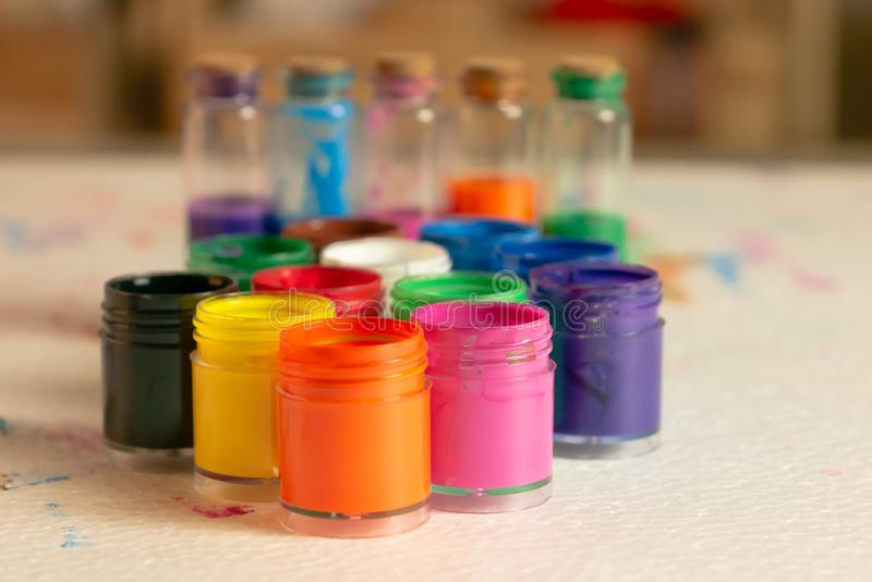 Color bottles on the white foam pad royalty free stock photos