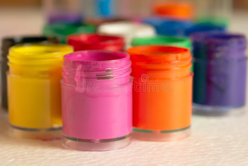 Color bottles placed on white foam pads royalty free stock photos