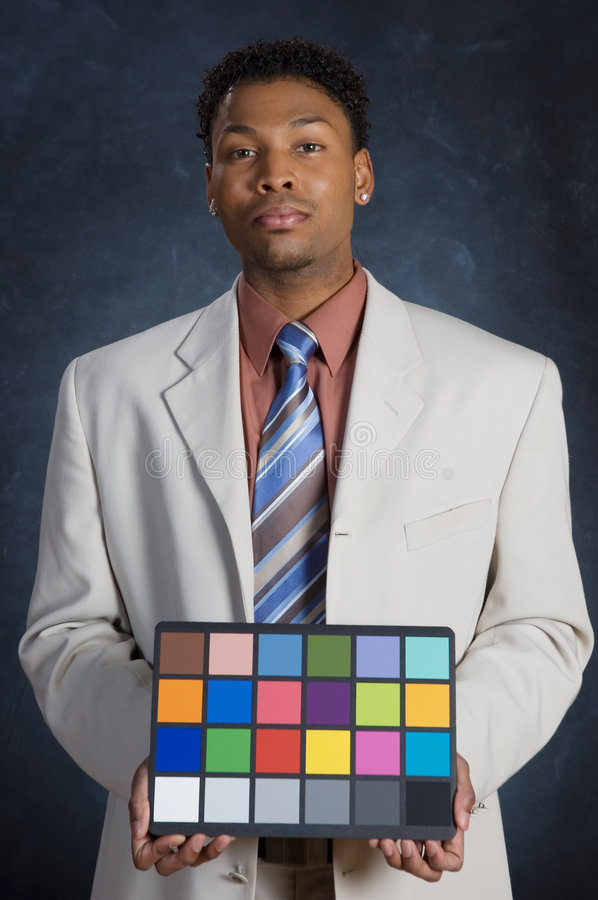 Color Card. A man in a suit holding a color card royalty free stock photos