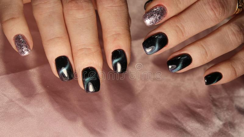 Hands of woman with black finger nails. Hands of woman with black nail polish on finger nails stock image