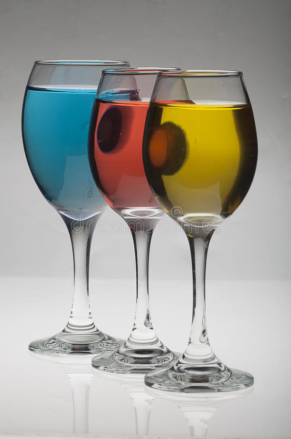 Color changes in the wine glasses stock photos
