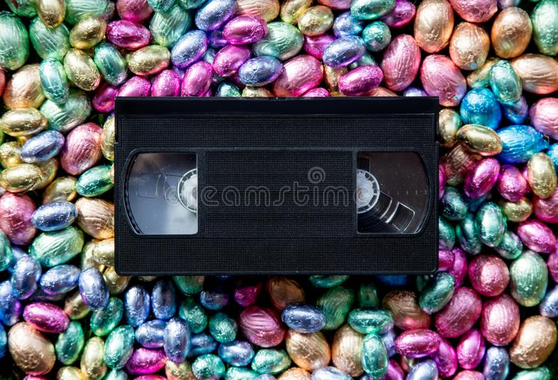 Color Chocolate Easter eggs and VHS cassette stock image