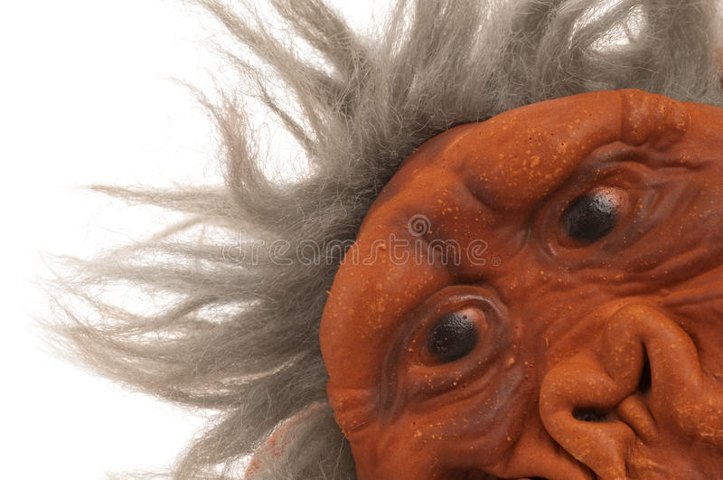 Color Closeup of a Monkey Face. A gray-haired monkey or ape head shot with face positioned in lower right corner of frame stock photography