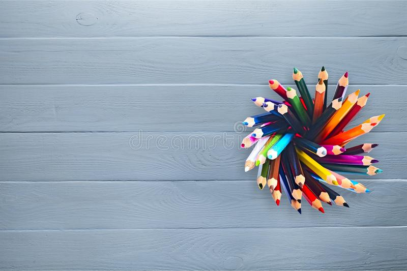 Colored pencils in tin can on background, top view royalty free stock images