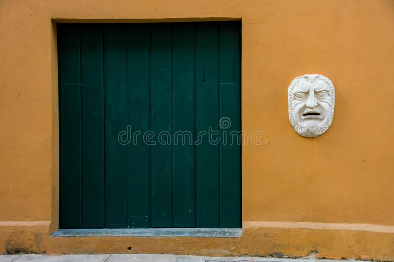 Color contrasts on the building walls in Havana, Cuba. And one mailbox stock image