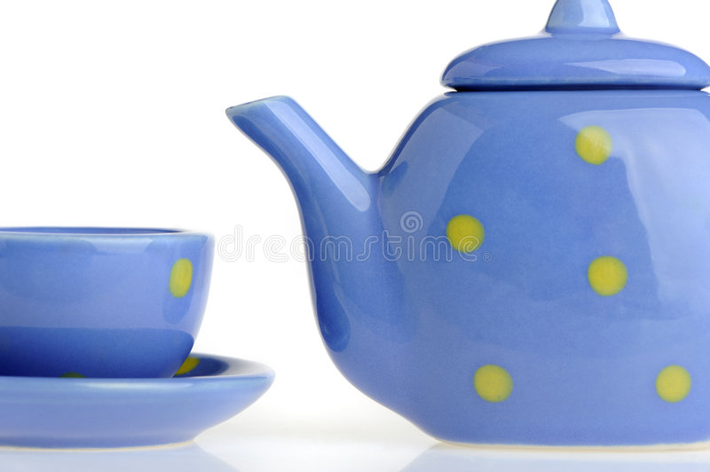 Color cup and teakettle. Tiny utensils it is isolated on a white background stock images