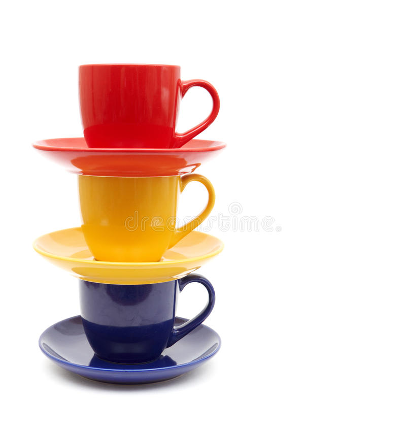 Color cups on a white background. royalty free stock photo