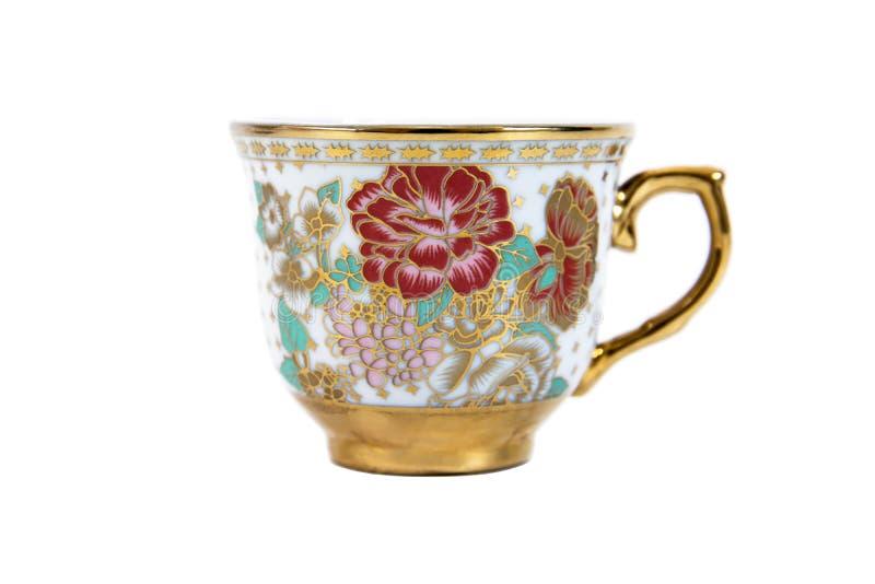 Color de la taza de café del oro aislado en el fondo blanco foto de archivo libre de regalías