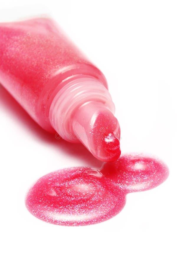 Color del rosa del lustre del labio del tubo en el fondo blanco imágenes de archivo libres de regalías