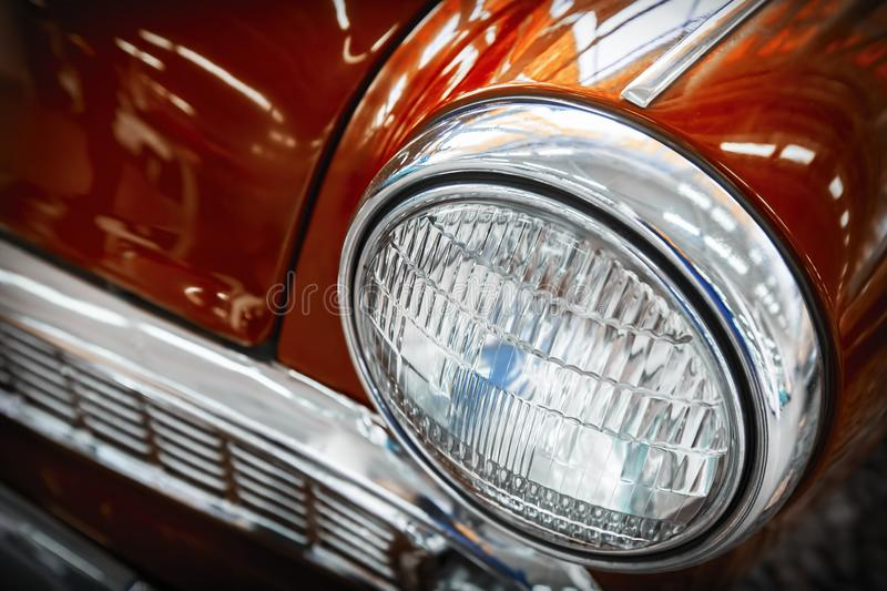 Color detail on the headlight of a vintage car. royalty free stock photos