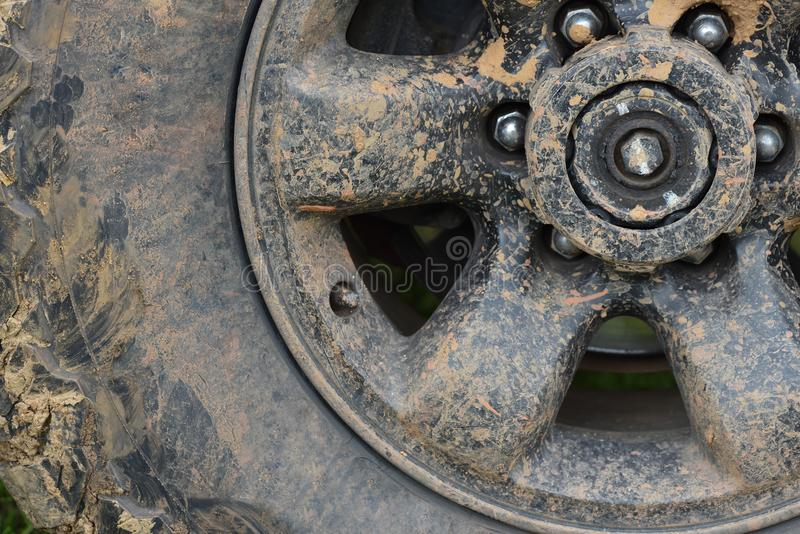 Color detail shot of an off-road car`s wheel, covered in mud.  royalty free stock photo