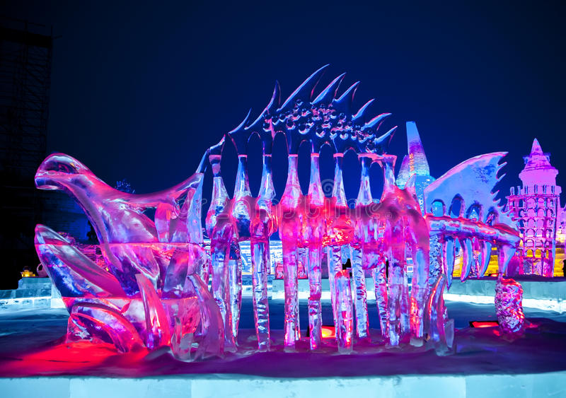 Color dinosaur ice sculpture stock image