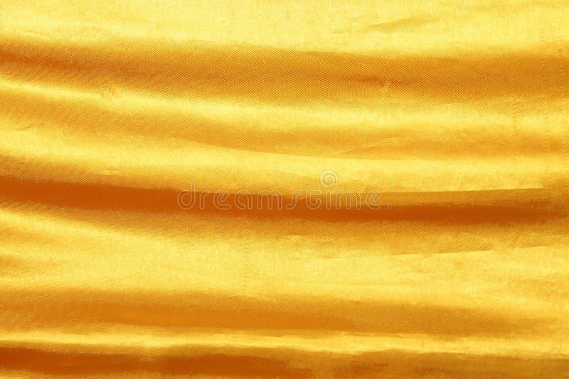 Color dorado de tela de tela de arruga para textura de fondo y diseño imagen de archivo libre de regalías