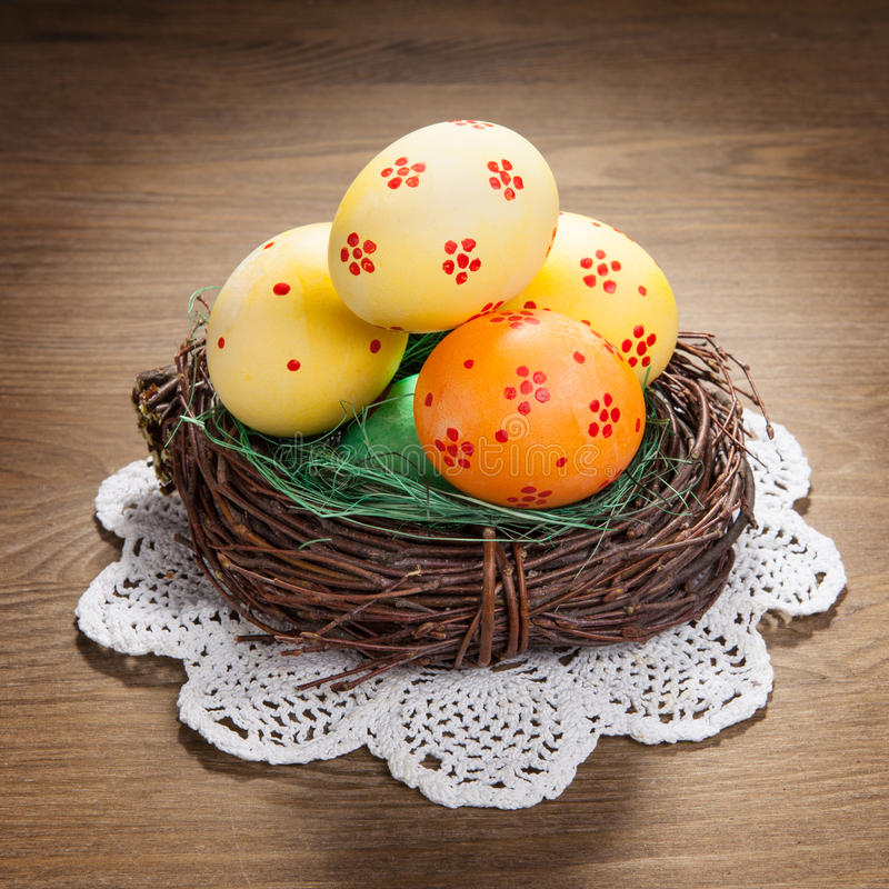 Color Easter eggs in the nest royalty free stock image
