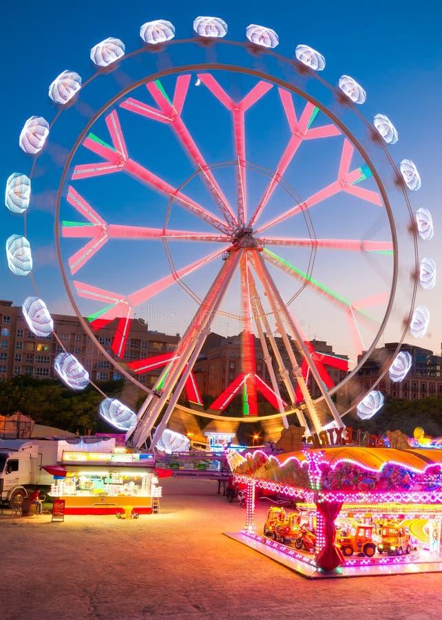 Color Ferris Wheel in Turia Park in Valencia, Spain. VALENCIA, SPAIN- JULY 01, 2015: Color Ferris Wheel in Turia Park in Valencia, Spain stock images