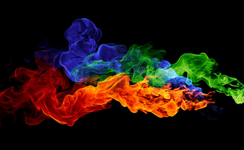 Color fire - red, blue & green flames. On a black background royalty free stock photography