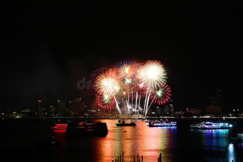 color fireworks on beach and reflection color on water surface royalty free stock photography