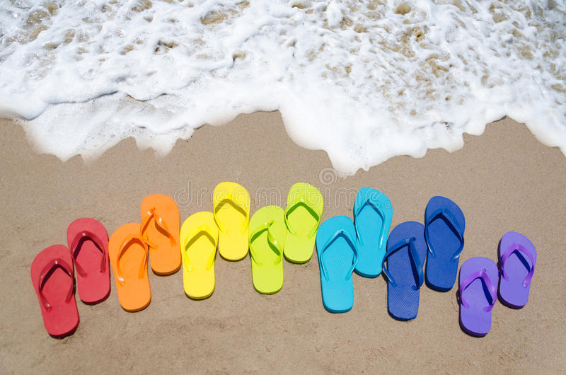 Color flip flops by the ocean stock image