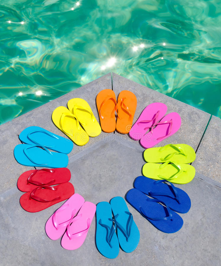 Color flip flops by the pool royalty free stock photography