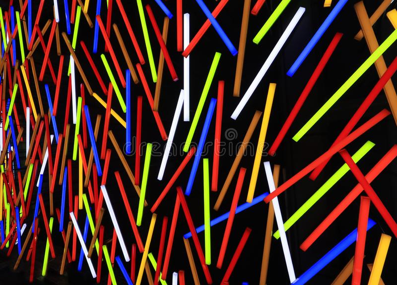 Color fluorescent neon tube wall  lights as a colorful Stripe pattern background. royalty free stock photo