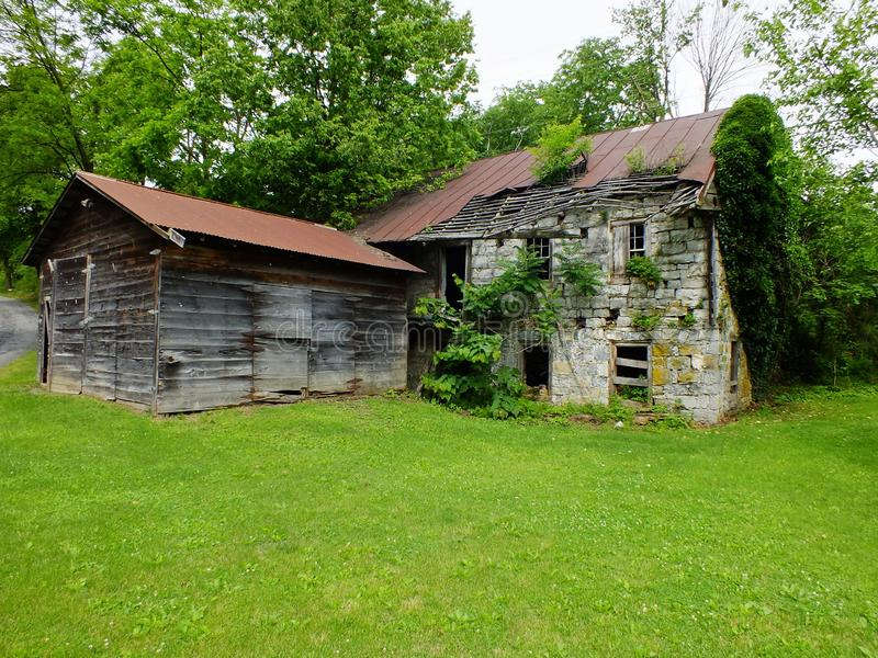Abandoned Barn. A color image of a abandoned barn left for mother nature to reclaim royalty free stock photos