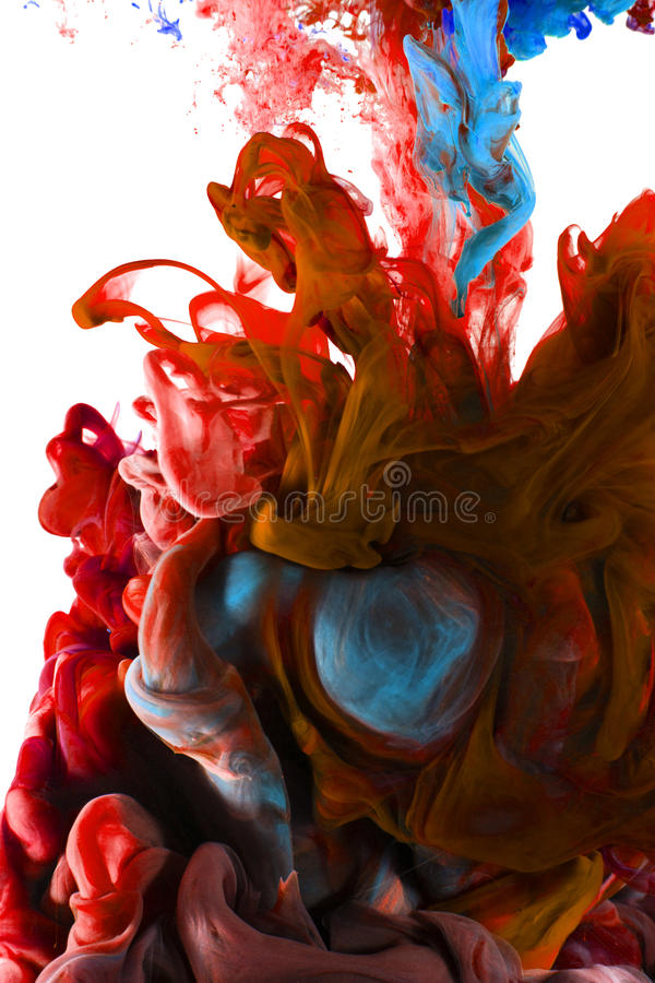 Color ink drop in water. Saphire blue, fiery red. Colors dropped into liquid, photographed n in motion. Ink swirling in water. Cloud of silky ink in liquid royalty free stock image