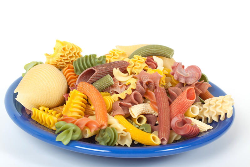 Download Color Italien Pasta On Blue Plate Stock Photo - Image: 14034704
