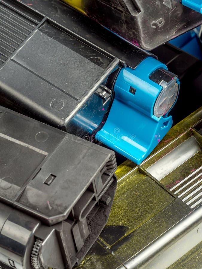 Color laser printer toner cartridges. Pile of used color laser printer toner cartridges royalty free stock image