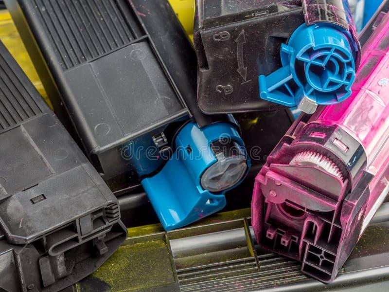 Color laser printer toner cartridges. Pile of used color laser printer toner cartridges stock photo