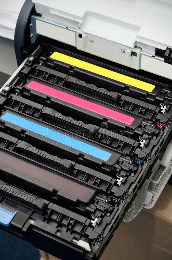 Color laser printer toners cartridges. Closeup of color laser printer toners cartridges royalty free stock image