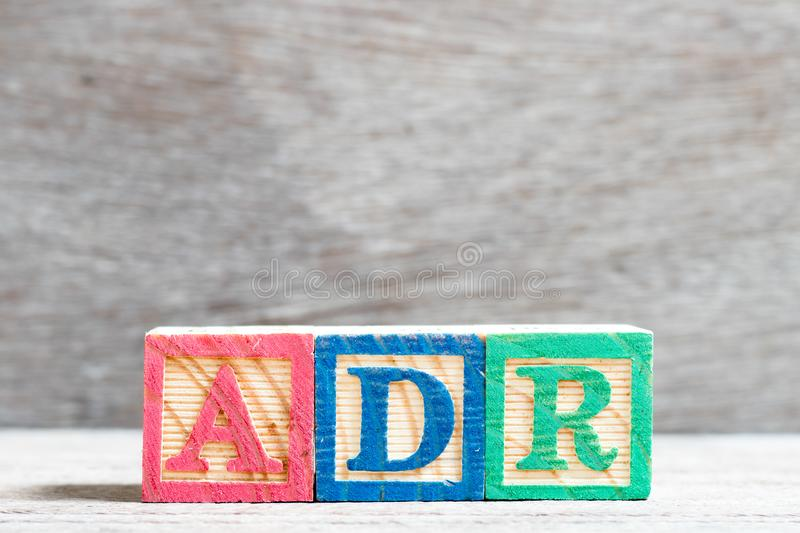 Color letter block in word ADR adverse drug reaction on wood background. Color letter block in word ADR Abbreviation of adverse drug reaction on wood background stock photo